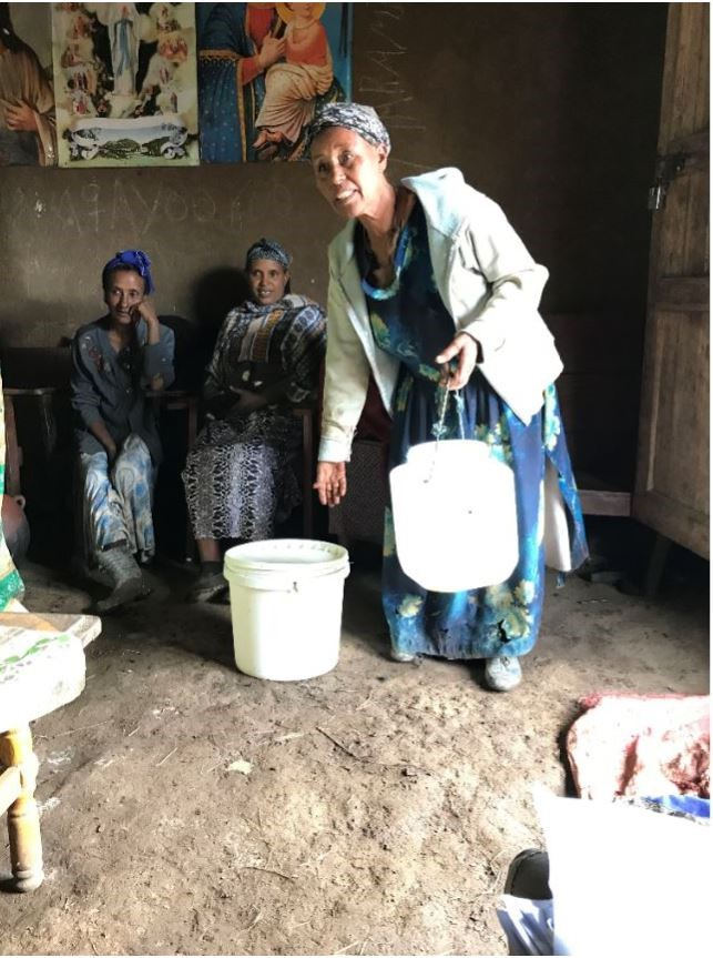 Women and paint bucket for milk container
